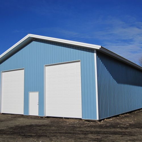 Roof - Rolled Rib Polar White; Walls -Lt Blue
